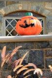 Big grinning Jack-O-Lantern on stonewall Stock Photo