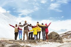 Big group happy friends mountains travel. Big group of happy friends standing, hugging and looking at mountains. Travel concept stock images