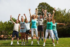 Big group of jumping people. Big group of mature jumping people with hands up Stock Photos