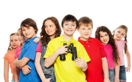 Smiling boy with binoculars in a group Royalty Free Stock Photos