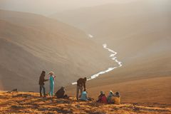 Big group of peoples on mountain top stock images