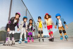 In-line skaters standing together holding hands Stock Photos