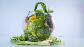Big group of vegetables on a vase on white background stock video footage