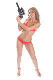 Big gun. Beautiful girl in red bikini with the big black gun isolated on white Stock Images