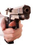 Big gun in female hand. Royalty Free Stock Image