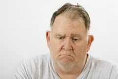 Big guy depressed. Big in a depressed state of mind royalty free stock photo