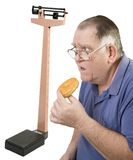 Big Guy, donut and scale royalty free stock photography