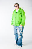 Big guy in a green shirt and jeans Stock Photos
