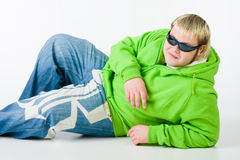 Big guy in a green shirt and jeans Royalty Free Stock Image