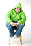 Big guy sitting on a chiar Royalty Free Stock Photos