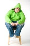 Big guy sitting on a chiar Royalty Free Stock Photos