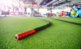 Big gym, sunshine coming, battle ropes lie on the ground Stock Photo