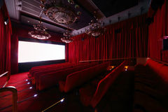Big hall with large beautiful chandeliers in cinema royalty free stock photography