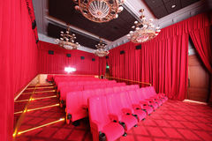 Big hall with red curtains in cinema Stock Photography