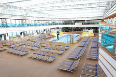 Big hall for rest and tan with swimming pool Stock Images