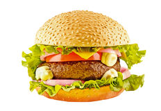 Big hamburger with beef cutlet and vegetables on white backgound Royalty Free Stock Photos