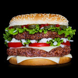 Big hamburger on black background Stock Image