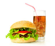 Big hamburger and cola with ice cubes Stock Photography