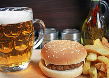 Big hamburger with french fries and beer Stock Image