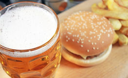 Big hamburger with french fries and beer Royalty Free Stock Photography