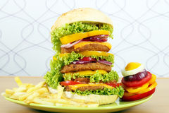 Big hamburger with french fries Royalty Free Stock Photography