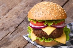 Big hamburger with fresh vegetables, cheese and meat Stock Photography