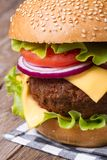 Big hamburger with meat, cheese, tomato, onion and lettuce Stock Image