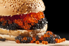 Big hamburger with red and black caviar Stock Photo