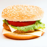 Big hamburger with sesame seeds, fresh vegetables and juicy meat Royalty Free Stock Photography