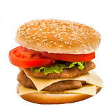 Big hamburger with sesame seeds, fresh vegetables and juicy meat Stock Images