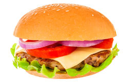 Big hamburger on white background. Big beautiful juicy burger with meat and vegetables. Isolated on white background Royalty Free Stock Images