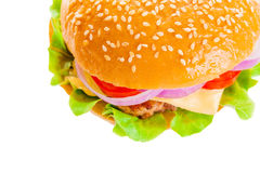 Big hamburger on white background. Big beautiful juicy burger with meat and vegetables. Isolated on white background Royalty Free Stock Photos