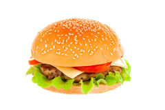 Big hamburger on white background. Big beautiful juicy burger with meat and vegetables. Isolated on white background Royalty Free Stock Photo