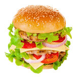 Big hamburger on white background. Big beautiful juicy burger with meat and vegetables. Isolated on white background Stock Image