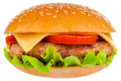 Big hamburger on white background. Big beautiful juicy burger with meat and vegetables. Isolated on white background Stock Photography