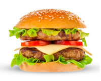 Big hamburger on white background. Big beautiful juicy burger with meat and vegetables. Isolated on white background Stock Photos