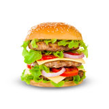 Big hamburger on white background. Big beautiful juicy burger with meat and vegetables. Isolated on white background Royalty Free Stock Photography