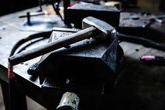 Big hammer on anvil in blacksmith workshop Royalty Free Stock Photo