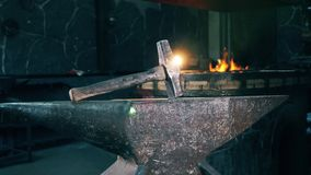 A big hammer on anvil at a forge.