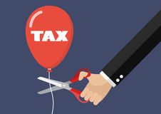 Big hand cutting tax balloon string with scissors Royalty Free Stock Photography