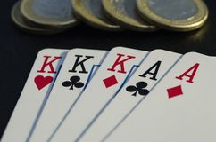 Big hand with full kings and aces royalty free stock image