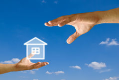Big hand give the house icon to small hand Royalty Free Stock Photography