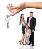 Big hand give keys to young family Stock Photography
