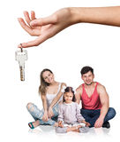 Big hand give keys to young family Stock Images