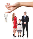 Big hand give keys to young family Stock Photo