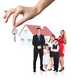 Big hand give keys to young family Royalty Free Stock Photo