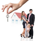 Big hand give keys to young family Royalty Free Stock Photography