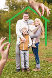 Big hand give keys to young family Royalty Free Stock Images
