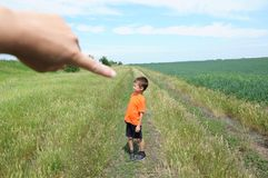 Big hand of god point little tiny boy in field. Big hand of god point little tiny boy in the field stock photos