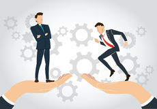 Big hand holding businessman and gears background ,  business concept Royalty Free Stock Images